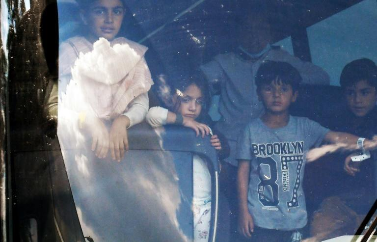 Afghan refugees arriving on a bus at a resettlement center in Chantilly, Virginia