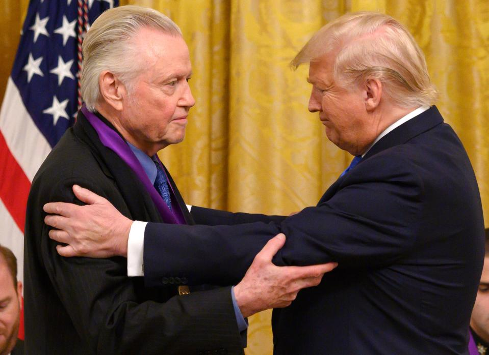 Jon Voight (L) was awarded the National Medal of Arts by President Donald Trump (R) on November 21, 2019. (Photo: Andrew CABALLERO-REYNOLDS / AFP) (Photo by ANDREW CABALLERO-REYNOLDS/AFP via Getty Images)