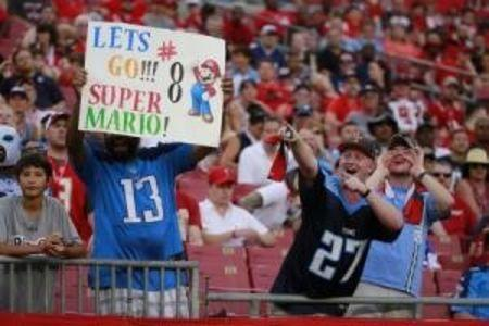 Sep 13, 2015; Tampa, FL, USA; Tennessee Titans fans hold up a sign for quarterback Marcus Mariota (not pictured) against the Tampa Bay Buccaneers during the second half at Raymond James Stadium. Mandatory Credit: Kim Klement-USA TODAY Sports
