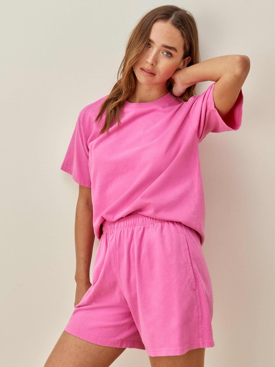 """These hot pink short are relaxed enough for lounging but also hella cute if you're trying to get a pic for your feed. Thanks, Ref. $58, Reformation. <a href=""""https://www.thereformation.com/products/boyfriend-knit-short?color=Shocking+Pink"""" rel=""""nofollow noopener"""" target=""""_blank"""" data-ylk=""""slk:Get it now!"""" class=""""link rapid-noclick-resp"""">Get it now!</a>"""