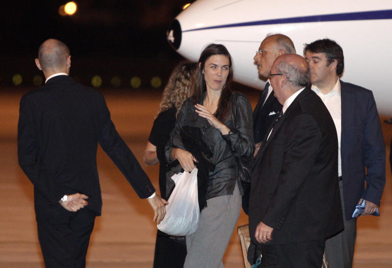 Australian lawyer Melinda Taylor, third from left, prepares to board a plane to Rotterdam after disembarking from Tripoli at Rome's Ciampino  military airport after being released from Libya, Monday, July 2, 2012. Taylor is one of the four International Criminal Court staffers who had been held for nearly four weeks on allegations that they shared documents that could harm national security with Moammar Gadhafi's imprisoned son Seif al-Islam Gadhafi. (AP Photo/Riccardo De Luca)