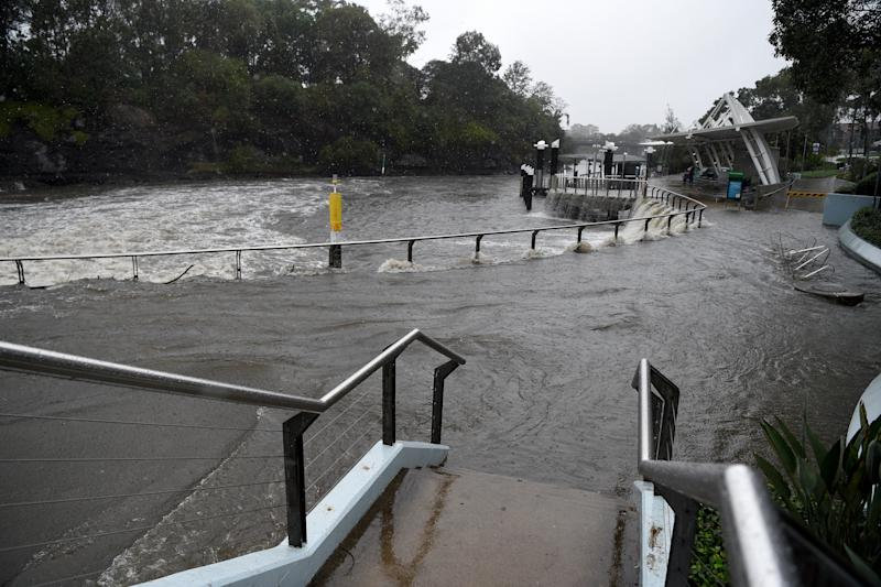 Water overflows the banks of the Parramatta River after heavy rains in Sydney, Friday, February 7, 2020.