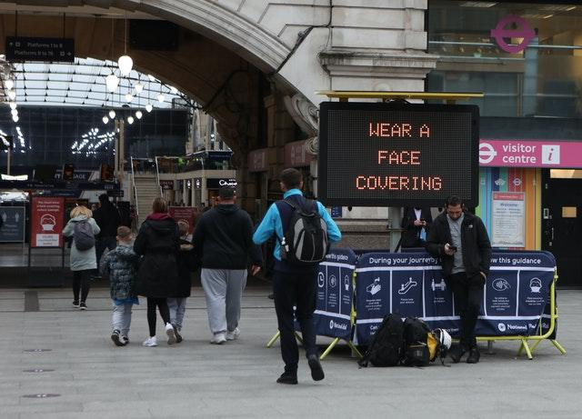 A sign to promote the wearing of face coverings at Victoria station (Luciana Guerra/PA)