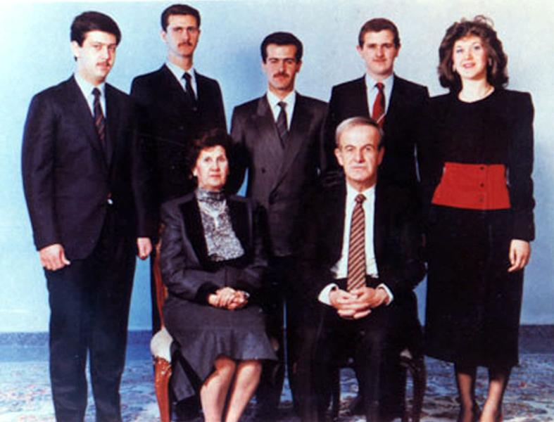 FILE - In this is an undated official portrait of Syrian President Hafez Assad, right foreground, with his wife, Anissa Makhloof, foreground left, and children. His children are, from left to right, Maher, Bashar, Bassel (who died in a car accident in 1994), Majd and Bushra. He is hardly ever photographed or even quoted in Syria's media. Wrapped in that blanket of secrecy, President Bashar Assad's younger brother has been vital to the family's survival in power. Maher Assad commands the elite troops that protect the Syrian capital from rebels on its outskirts and is widely believed to have helped orchestrate the regime's fierce campaign to put down the uprising, now well into its third year. (AP Photo/Syrian Ministry of Information, File)