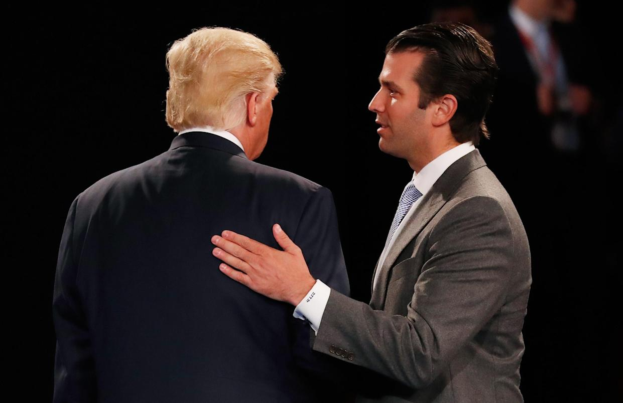 Donald Trump Jr. greets his father during a town hall debate in St. Louis, Oct. 9, 2016. (Photo: Rick Wilking-Pool/Getty Images)