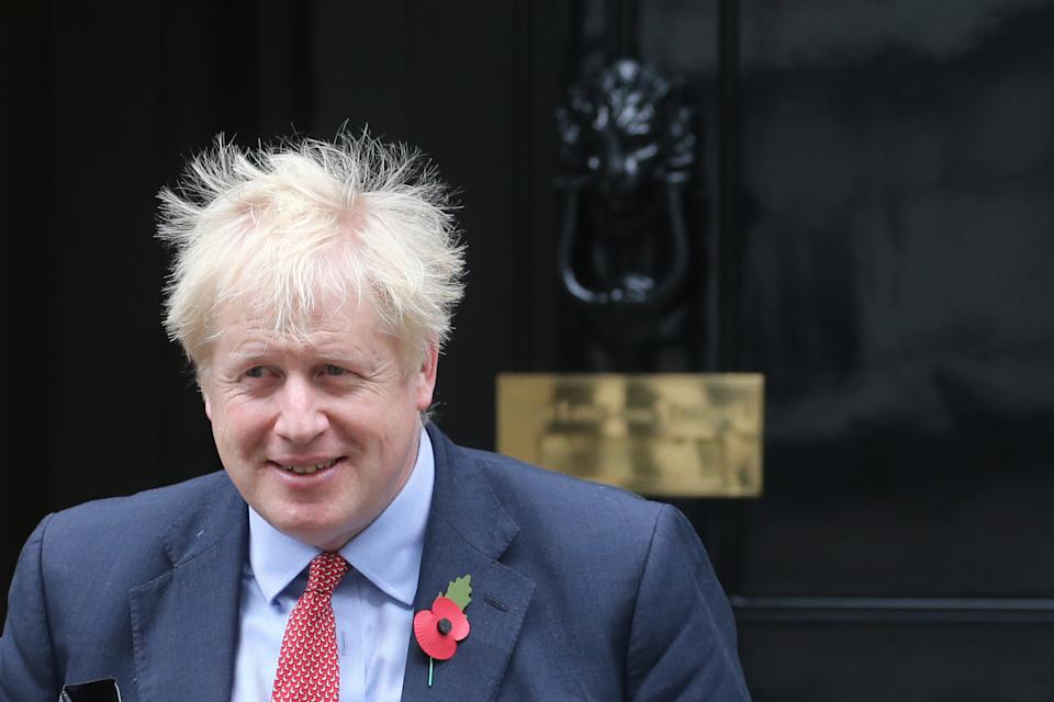 Britain's Prime Minister Boris Johnson leaves number 10, Downing street in London on October 29, 2019. - British Prime Minister Boris Johnson is expected to make a fresh attempt today to force an early election, despite MPS rejecting his plan, after the European Union agreed to postpone Brexit for up to three months. (Photo by ISABEL INFANTES / AFP) (Photo by ISABEL INFANTES/AFP via Getty Images)