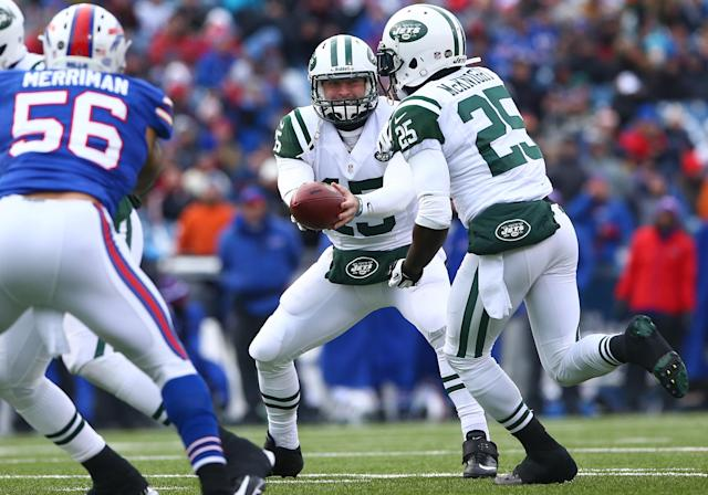 ORCHARD PARK, NY - DECEMBER 30: Tim Tebow #15 of the New York Jets hands the ball off to Joe McKnight #25 during an NFL game against the Buffalo Bills at Ralph Wilson Stadium on December 30, 2012 in Orchard Park, New York. (Photo by Tom Szczerbowski/Getty Images)