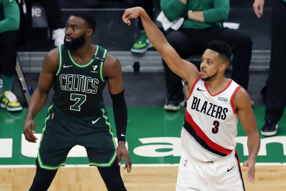 Portland Trail Blazers' CJ McCollum (3) shoots a 3-pointer against Boston Celtics' Jaylen Brown (7) during the second half of an NBA basketball game, Sunday, May 2, 2021, in Boston. (AP Photo/Michael Dwyer)