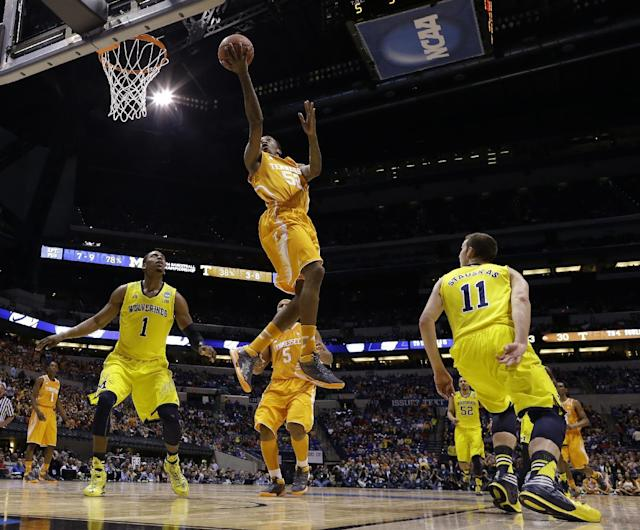 Tennessee's Jordan McRae shoots during the first half of an NCAA Midwest Regional semifinal college basketball tournament game against the Michigan Friday, March 28, 2014, in Indianapolis. (AP Photo/Michael Conroy)