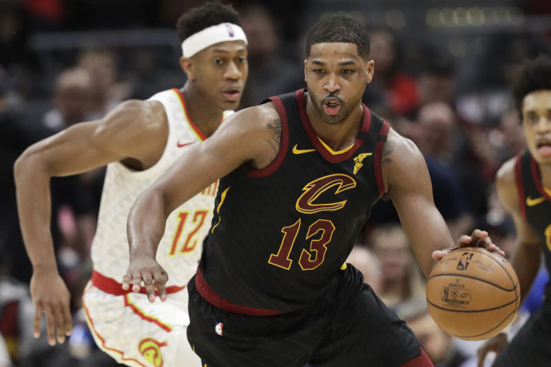 Cleveland Cavaliers' Tristan Thompson (13) drives against Atlanta Hawks' De'Andre Hunter (12) in the second half of an NBA basketball game, Wednesday, Feb. 12, 2020, in Cleveland. The Cavaliers won 127-105. (AP Photo/Tony Dejak)