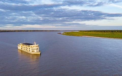 Delfin III sails along the Amazon, taking in the river's beauty