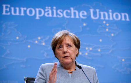 German Chancellor Angela Merkel attends a news conference after the EU summit in Brussels