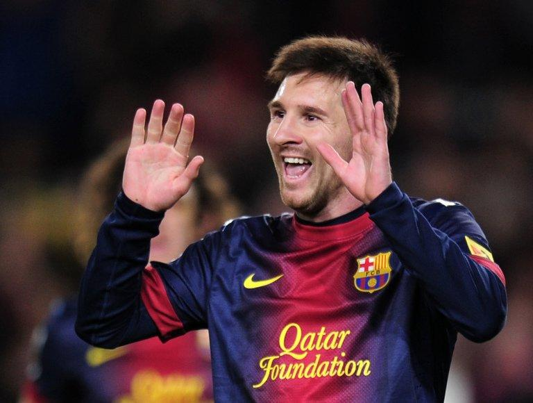 Barcelona's Lionel Messi celebrates after scoring a goal during their Spanish La Liga match against Espanyol, at the Camp Nou stadium in Barcelona, on January 6, 2013. Barcelona may be 11 points ahead of their nearest rivals, Atletico Madrid, but Messi, who this week won his fourth consecutive Ballon d'Or, is keeping his feet on the ground regarding the title race