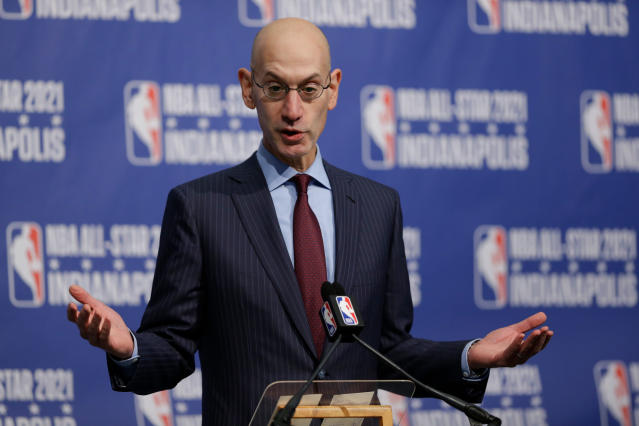 FILE - In this Dec. 13, 2017, file photo, NBA Commissioner Adam Silver gestures during a press conference in Indianapolis. The commission proposing reforms to college basketball wants 18-year-olds to be eligible again for the NBA draft, and the NBA Players Association would make that deal today. Change will take longer than that. NBA Commissioner Adam Silver senses the league's age limit isn't working. Requiring U.S. players to be 19 years old and one year removed from high school has sent many of them to a year of college they don't want, and delayed the full-time basketball instruction pro teams prefer. But whether the league would agree to allow players to come straight from high school again, or want them to wait two years before becoming draft eligible, has been a sticking point practically since the age limited was enacted in 2005 and remains unclear now. (AP Photo/Michael Conroy, File)