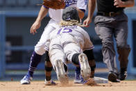 Colorado Rockies' Raimel Tapia steals second during the fifth inning of a baseball game against the Los Angeles Dodgers Sunday, July 25, 2021, in Los Angeles. (AP Photo/Mark J. Terrill)
