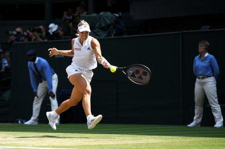 Tennis - Wimbledon - All England Lawn Tennis and Croquet Club, London, Britain - July 12, 2018. Germany's Angelique Kerber in action in during her semi final match against Latvia's Jelena Ostapenko. Neil Hall/pool via Reuters