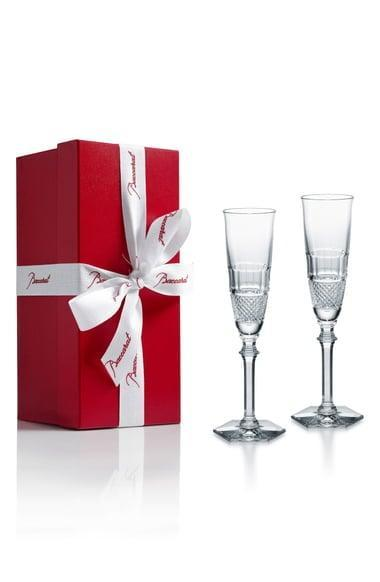 <p>The <span>Baccarat Diamant Set of 2 Lead Crystal Champagne Flutes</span> ($380) are the fanciest drinkware they'll own.</p>