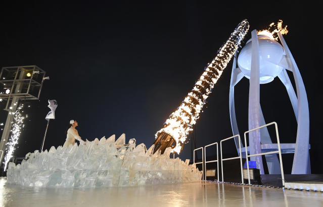 Yuna Kim lights the Olympic flame during Friday's opening ceremony. (AP)