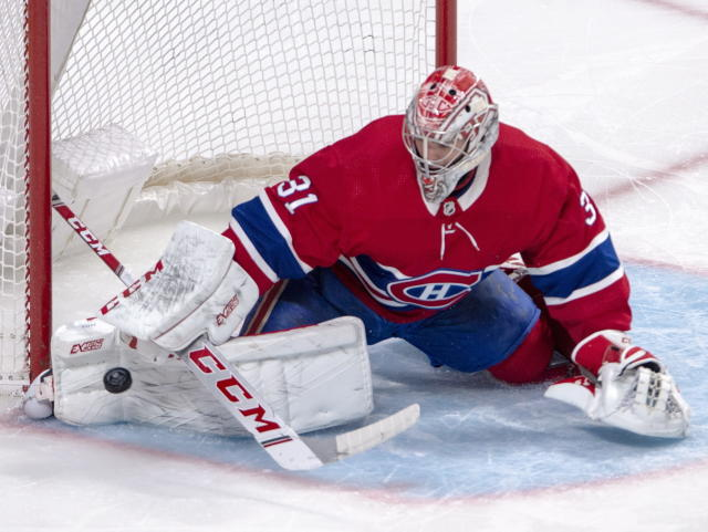 Montreal Canadiens goaltender Carey Price (31) makes a save during second period NHL hockey action against the New York Islanders, Tuesday, Dec. 3, 2019 in Montreal. (Ryan Remiorz/The Canadian Press via AP)