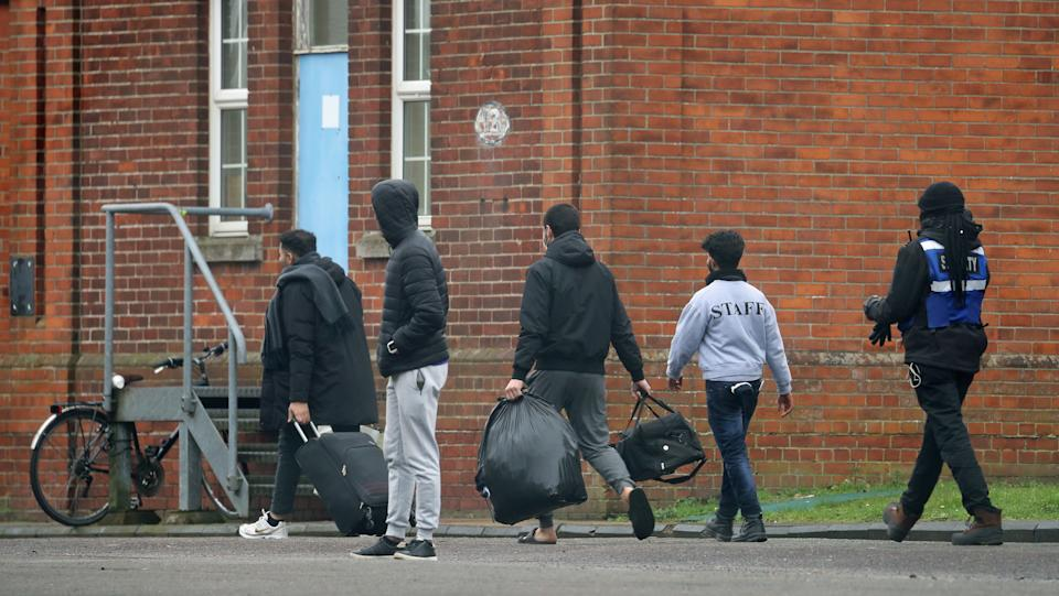 Two men leave Napier Barracks in Folkestone, Kent, which is currently being used by the government to house people seeking asylum in the UK. Friday. Picture date: Thursday February 4, 2021. (Photo by Gareth Fuller/PA Images via Getty Images)