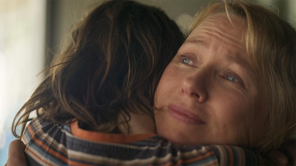 Naomi Watts as Sam Bloom hugs her son Noah, played by Griffin Murray-Johnston. Photo: supplied)