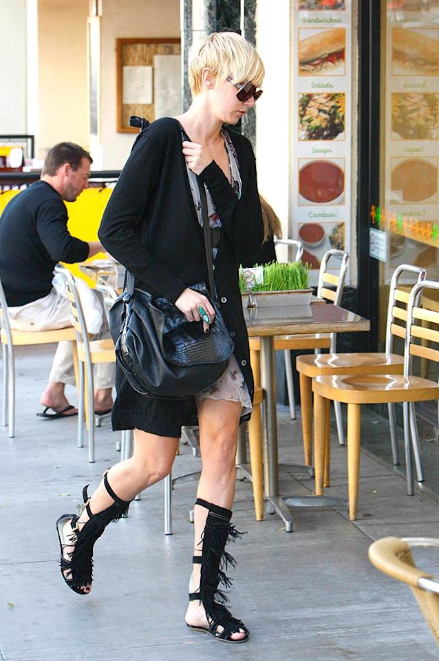 "Thank goodness Kimberly Stewart has come out of hiding; we've missed her outrageous ensembles! This week, Kimbo sports high-top gladiator sandals adorned with an abundance of fringe. Revolutionpix/<a href=""http://www.infdaily.com"" target=""new"">INFDaily.com</a> - April 15, 2008"