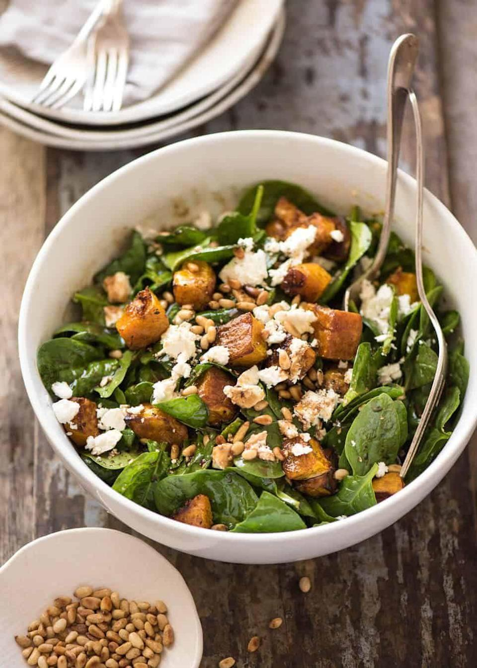 """<p>Who says salads need to be boring?! Load up your greens with tender roasted pumpkin, pine nuts, and tangy feta for a delicious fall lunch or hearty side. </p><p><strong>Get the recipe at <a href=""""https://www.recipetineats.com/roast-pumpkin-spinach-and-feta-salad/"""" rel=""""nofollow noopener"""" target=""""_blank"""" data-ylk=""""slk:Recipe Tin Eats"""" class=""""link rapid-noclick-resp"""">Recipe Tin Eats</a>. </strong></p><p><a class=""""link rapid-noclick-resp"""" href=""""https://go.redirectingat.com?id=74968X1596630&url=https%3A%2F%2Fwww.walmart.com%2Fsearch%2F%3Fquery%3Dpioneer%2Bwoman%2Bsalad%2Bbowl&sref=https%3A%2F%2Fwww.thepioneerwoman.com%2Ffood-cooking%2Fmeals-menus%2Fg37022645%2Fhealthy-pumpkin-recipes%2F"""" rel=""""nofollow noopener"""" target=""""_blank"""" data-ylk=""""slk:SHOP SALAD BOWLS"""">SHOP SALAD BOWLS</a></p>"""
