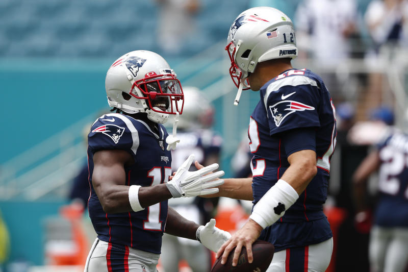 New England Patriots quarterback Tom Brady (12) greets wide receiver Antonio Brown (17). (AP Photo/Brynn Anderson)