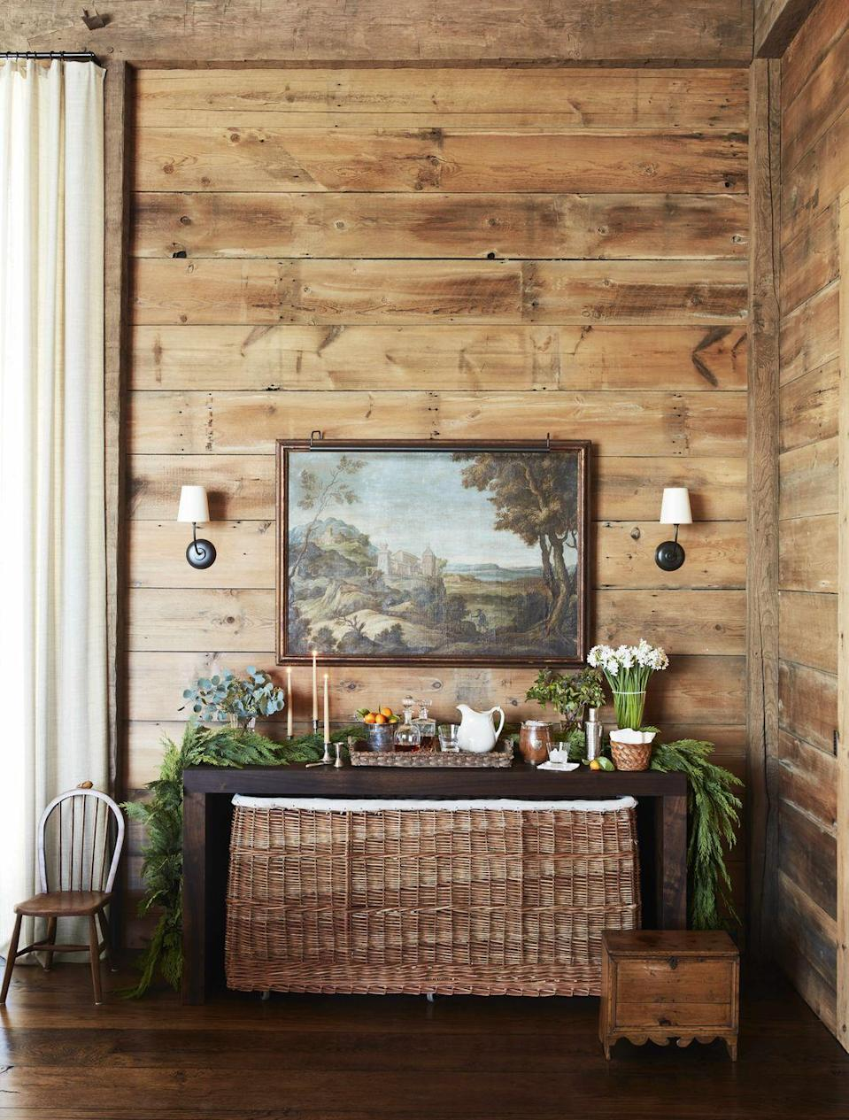 "<p>In this <a href=""https://www.veranda.com/decorating-ideas/a29416530/gil-schafer-vermont-party-barn/"" rel=""nofollow noopener"" target=""_blank"" data-ylk=""slk:Vermont party barn"" class=""link rapid-noclick-resp"">Vermont party barn</a> designed by <a href=""https://gpschafer.com/"" rel=""nofollow noopener"" target=""_blank"" data-ylk=""slk:Gil Schafer"" class=""link rapid-noclick-resp"">Gil Schafer</a>, a custom wicker and leather log basket (<a href=""https://howelondon.com/"" rel=""nofollow noopener"" target=""_blank"" data-ylk=""slk:Howe London"" class=""link rapid-noclick-resp"">Howe London</a>) snugly fits under a black walnut console. The versatile piece makes it easy to store linens for all sorts of occasions. </p>"