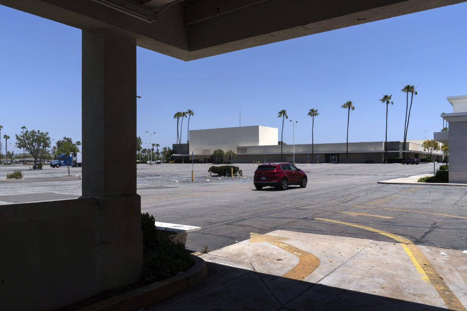 This Thursday, May 27, 2021, photo shows the closed Sears in Buena Park Mall in Buena Park, Calif. California state lawmakers are grappling with a particularly 21st-century problem: What to do with the growing number of shopping malls and big-box retail stores left empty by consumers shifting their purchases to the web. A possible answer in crowded California cities is to build housing on these sites, which already have ample parking and are close to existing neighborhoods. Even before the pandemic, big-box retail stores struggled to adapt as more people began buying things online. In 2019, after purchasing Sears and Kmart, Transformco closed 96 stores across the country, 29 in California. (AP Photo/Damian Dovarganes)