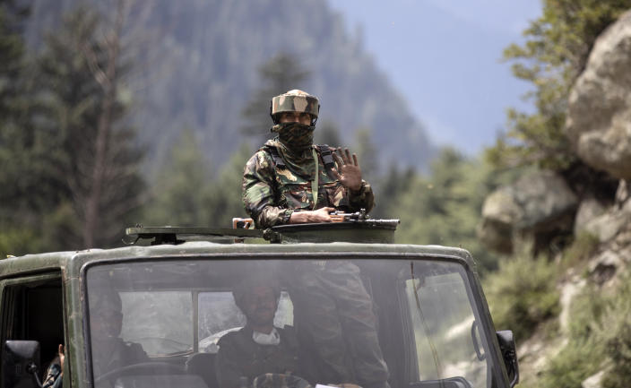 "An Indian army soldier keeps guard on top of his vehicle as their convoy moves on the Srinagar- Ladakh highway at Gagangeer, northeast of Srinagar, Indian-controlled Kashmir, Tuesday, Sept. 1, 2020. India said Monday its soldiers thwarted ""provocative"" movements by China's military near a disputed border in the Ladakh region months into the rival nations' deadliest standoff in decades. China's military said it was taking ""necessary actions in response,"" without giving details. (AP Photo/Mukhtar Khan)"
