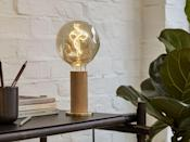 """<p>Designed to celebrate the simple beauty of the light bulb, this elegant Tala table lamp offers a simple and stylish design that looks good gracing any surface. Crafted with the planet in mind, the sustainable art piece comes complete with a tactile in-line dimmer to create accents of light and colour to suit different moods throughout the day.</p><p>From £155, <a href=""""https://www.tala.co.uk/product/knuckle-table-lamp-oak-voronoi-i/"""" rel=""""nofollow noopener"""" target=""""_blank"""" data-ylk=""""slk:Tala"""" class=""""link rapid-noclick-resp"""">Tala</a>.</p>"""