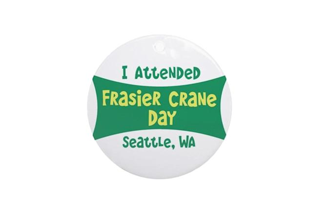 "<p>To celebrate its 100th episode, <em>Fraiser</em> held an actual live rally in Seattle — with star Kelsey Grammer singing the opening credits of the show. If you were there (or want to pretend like you were), mark the occasion on your tree with this ornament. <strong><a href=""http://www.cafepress.com/+,1205721151?utm_medium=cpc&utm_source=pla-google&utm_campaign=653160434-d-c&utm_content=32646451123-adid-96354637090&utm_term=aud-37047584530:pla-71921225770-pid-1205721151&gclid=Cj0KCQiA0vnQBRDmARIsAEL0M1kKPjilmj_Z65uHxbLsjfnU8-1v1PAwaxlJM98zwHcegSvg9swhyGIaAlWeEALw_wcB"" rel=""nofollow noopener"" target=""_blank"" data-ylk=""slk:Buy here"" class=""link rapid-noclick-resp"">Buy here</a></strong> </p>"