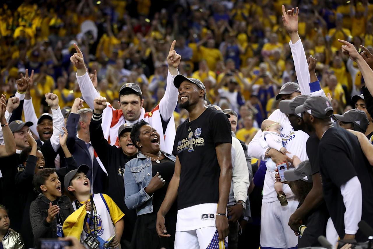 <p>Kevin Durant #35 of the Golden State Warriors celebrates with his mother Wanda after being named Bill Russell NBA Finals Most Valuable Player after defeating the Cleveland Cavaliers 129-120 in Game 5 to win the 2017 NBA Finals at ORACLE Arena on June 12, 2017 in Oakland, California. </p>