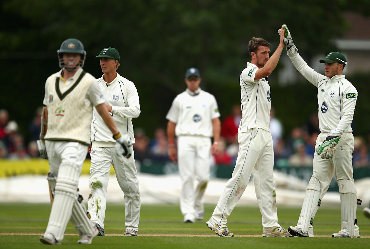 WORCESTER, ENGLAND - JULY 02: Jack Shantry of Worcestershire celebrates after taking the wicket of Chris Rogers of Australia during day one of the Tour Match between Worcestershire and Australia at New Road on July 2, 2013 in Worcester, England.  (Photo by Ryan Pierse/Getty Images)