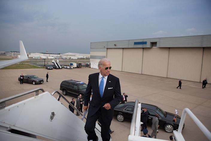 Welcome aboard: Vice President Joe Biden jogs up the stairs to Air Force Two at Lambert St. Louis International Airport, in St. Louis, Missouri, August 20,2010.