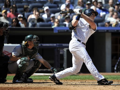 New York Yankees designated hitter Travis Hafner hits an RBI single off of Oakland Athletics starting pitcher Bartolo Colon in the sixth inning of a baseball game at Yankee Stadium on Saturday, May 4, 2013 in New York. (AP Photo/Kathy Kmonicek)