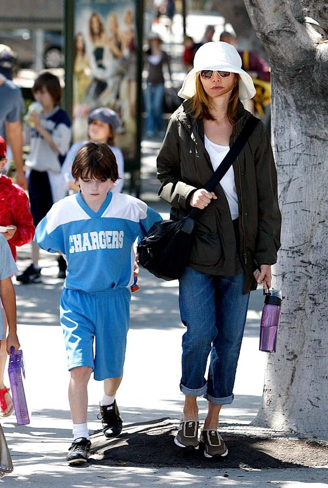 """Calista Flockhart was spotted leaving her son Liam's game in Brentwood, California on Saturday. Judging from the look on the 9-year-old's face, we're guessing his team lost. <a href=""""http://www.splashnewsonline.com/"""" target=""""new"""">Splash News</a> - May 22, 2010"""