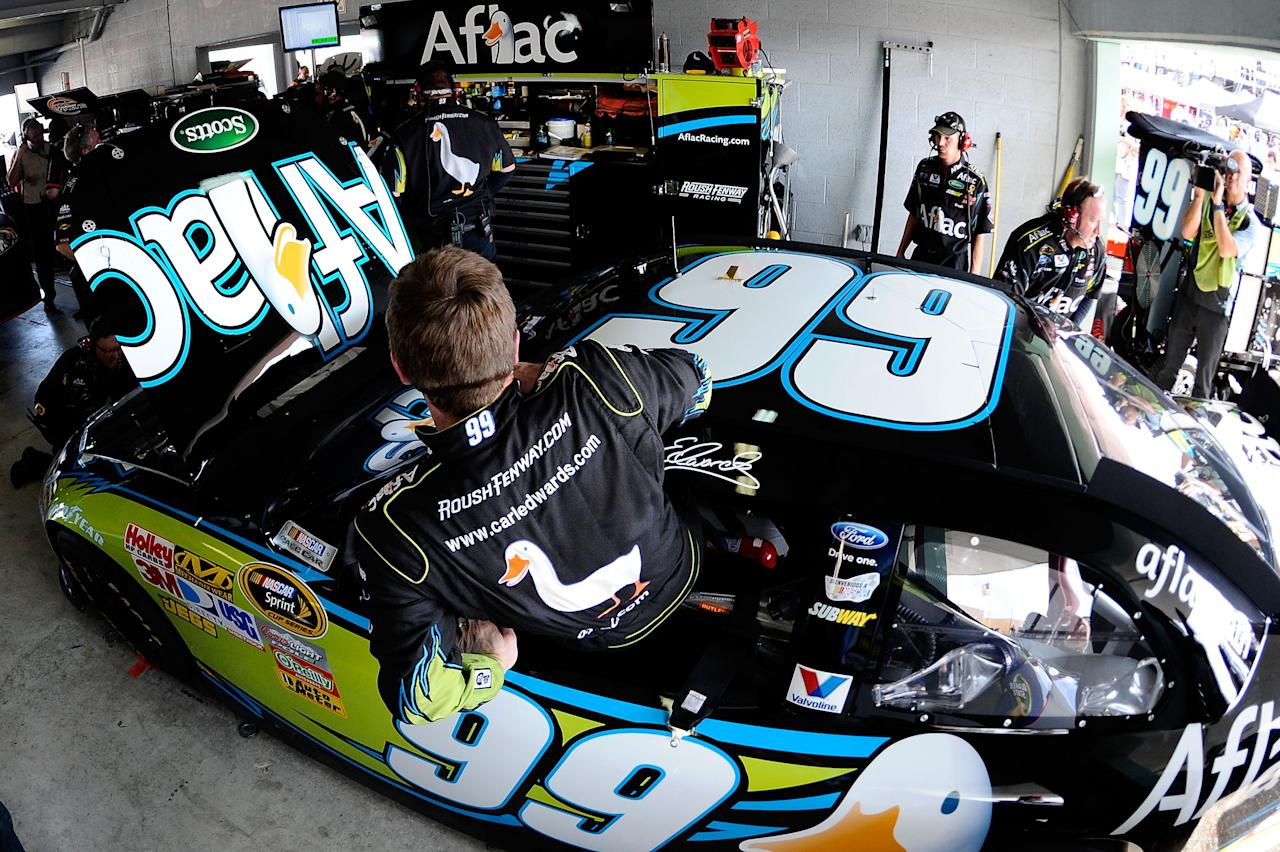 HOMESTEAD, FL - NOVEMBER 19:  Carl Edwards, driver of the #99 Aflac Ford, gets into his car during practice for the NASCAR Sprint Cup Series Ford 400 at Homestead-Miami Speedway on November 19, 2011 in Homestead, Florida.  (Photo by Jared C. Tilton/Getty Images)