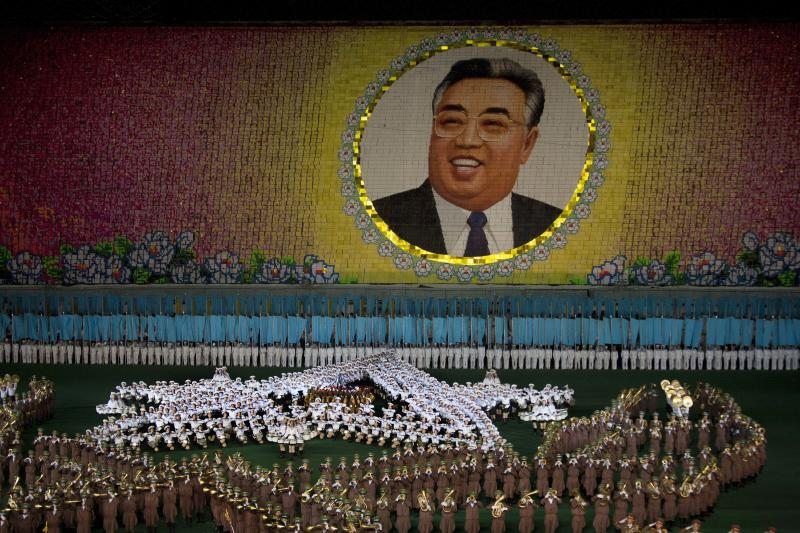 In this August 24, 2011 photo, a portrait of the late North Korean leader Kim Il Sung is made by people holding up colored cards at a stadium during an Arirang festival performance in Pyongyang. The tools for making the myth have been developed over two generations, dating back to Kim's father, late President Kim Il Sung.  (AP Photo/David Guttenfelder)
