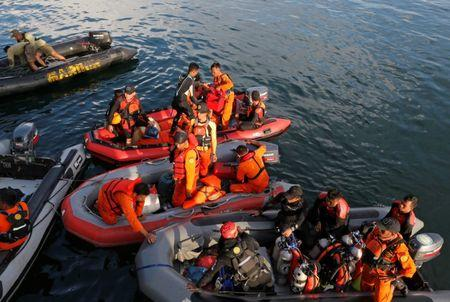 Rescuers operate rubber boats during a search and rescue operation for missing passengers from Monday's ferry accident at Lake Toba at Tigaras port in Simalungun, North Sumatra, Indonesia, June 21, 2018. REUTERS/Beawiharta