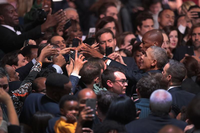 Obama greets guests following hisspeech.