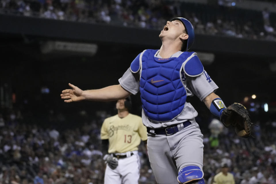 Los Angeles Dodgers catcher Will Smith watches the ball before making the catch for the out on a popup by Arizona Diamondbacks' Nick Ahmed (13) during the second inning of a baseball game Friday, July 30, 2021, in Phoenix. (AP Photo/Rick Scuteri)