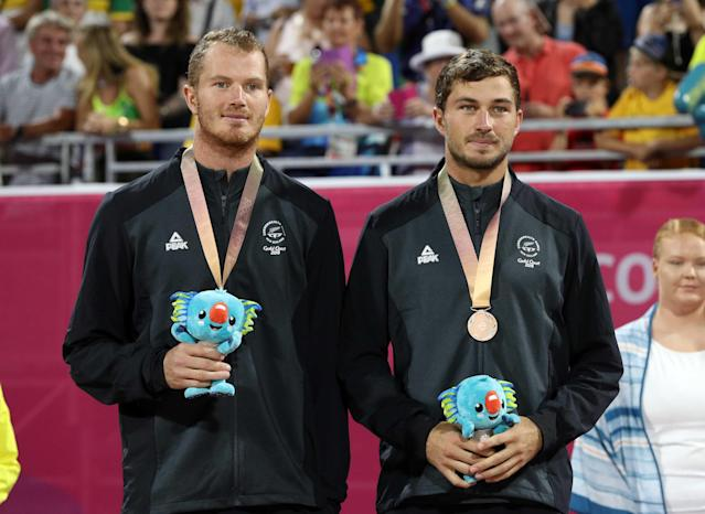 Beach Volleyball - Gold Coast 2018 Commonwealth Games - Men's Medal Ceremony - Coolangatta Beachfront - Gold Coast, Australia - April 12, 2018. Bronze medalists Ben O'Dea and Sam O'Dea of New Zealand on the podium. REUTERS/Athit Perawongmetha