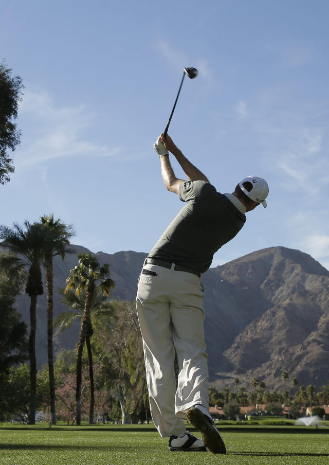 Brendon Todd watches his tee shot on the ninth hole during the third round of the Humana Challenge golf tournament at La Quinta Country Club on Saturday, Jan. 18, 2014 in La Quinta, Calif. (AP Photo/Chris Carlson)