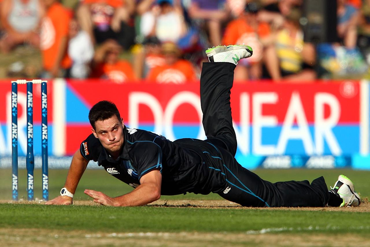 NAPIER, NEW ZEALAND - JANUARY 19:  Mitchell McClenaghan of New Zealand loses his footing while bowling during the first One Day International match between New Zealand and India at McLean Park on January 19, 2014 in Napier, New Zealand.  (Photo by Hagen Hopkins/Getty Images)
