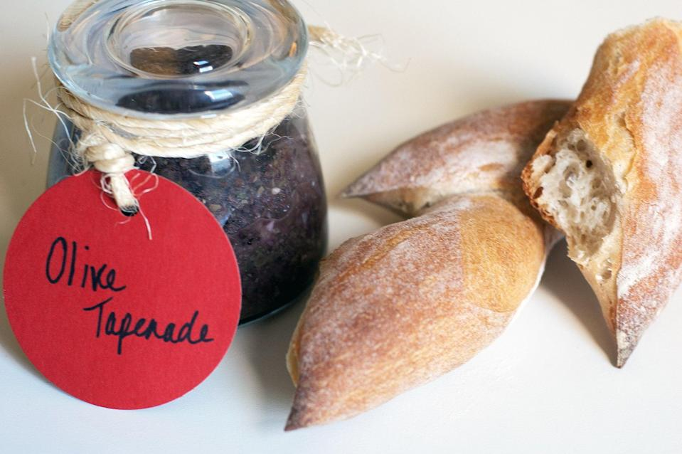 """<p><strong>Get the recipe:</strong> <a href=""""http://www.popsugar.com/food/Olive-Tapenade-Recipe-20732912/"""" class=""""link rapid-noclick-resp"""" rel=""""nofollow noopener"""" target=""""_blank"""" data-ylk=""""slk:olive tapenade"""">olive tapenade</a><br> <strong>Cans needed:</strong> olives, anchovies, capers</p>"""