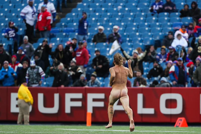 This streaker's mad dash gave Buffalo Bills fans a jolt of excitement during a blowout loss on Sunday. (Tom Szczerbowski via Getty Images)