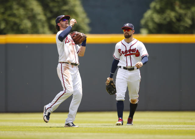 Atlanta Braves shortstop Dansby Swanson (7) catches a pop up for the final out of the ninth inning of a baseball game against the New York Mets, Wednesday, June 13, 2018, in Atlanta. The Braves beat the Mets 2-0. (AP Photo/Todd Kirkland)