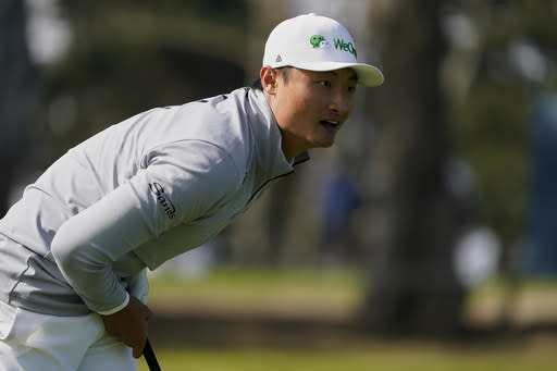 Haotong Li of China, watches his tee shot on the ninth hole during the second round of the PGA Championship golf tournament at TPC Harding Park Friday, Aug. 7, 2020, in San Francisco. (AP Photo/Charlie Riedel)